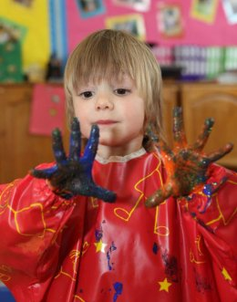 Child painting at Montessori nursery in Wheeler End, Bucks