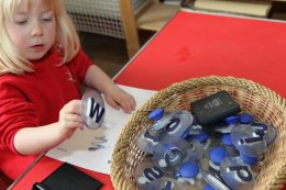 Child playing at Montessori nursery in Wheeler End, Bucks